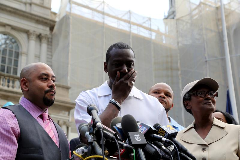 Raymond Santana (L), Yusef Salaam (C), Kevin Richardson (R) and Salaam's mother Sharonne Salaam speaking outside of City Hall after the city agreed to pay a $40 million settlement.