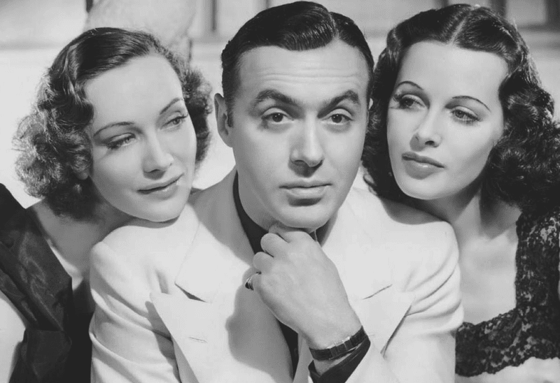 Charles Boyer with Sigrid Gurie (left) and Hedy Lamarr in Algiers (1938)