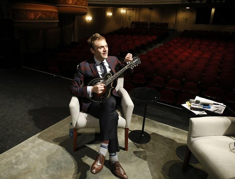 Chris Thile tunes his mandolin on the stage of the Fitzgerald Theater in St. Paul, Minn., Tuesday, April 5, 2016.