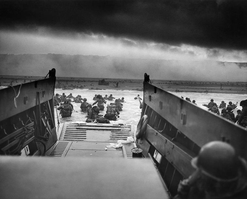 """Into the Jaws of Death — U.S. Troops wading through water and Nazi gunfire"" D-Day 1944."