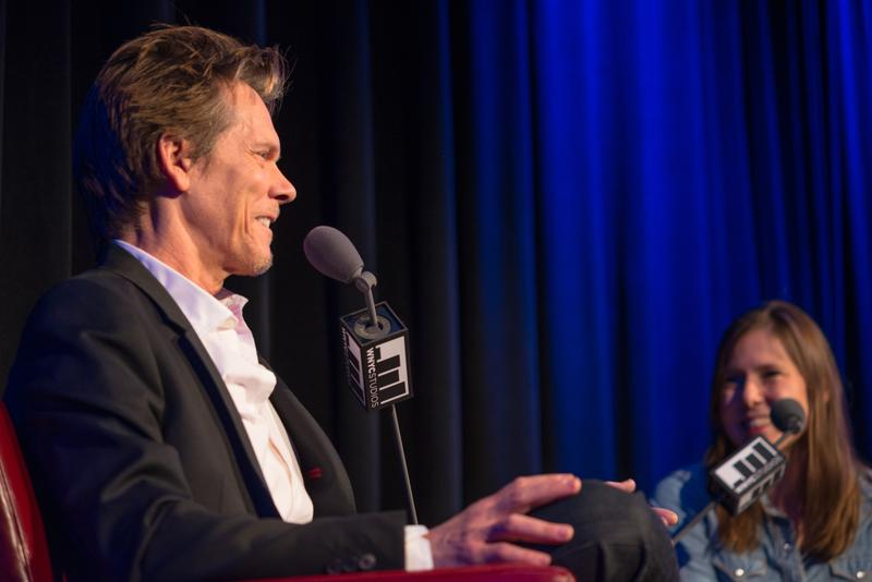 Kevin Bacon and host Anna Sale on stage at The Greene Space