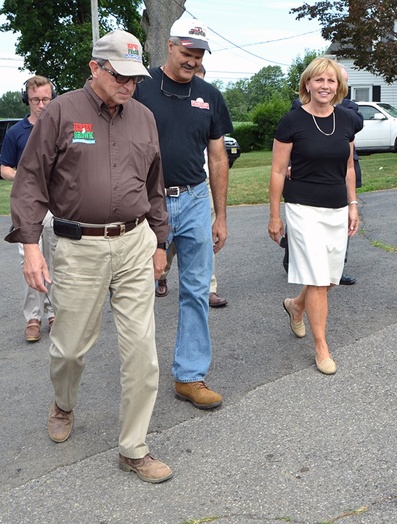 New Jersey Lt. Gov. Kim Guadagno tours a farm with state Secretary of Agriculture Douglas H. Fisher (left) and farmer Robert Fulper (right). WNYC reporter Matt Katz follows close behind.