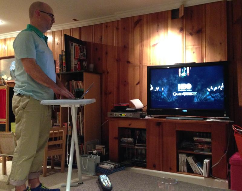 Dan Kois spent a month standing up. Here he is watching television on his feet.