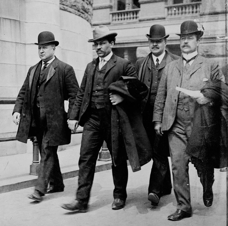 Detective Sergeant Joseph Petrosino, left, escorts Tomasso Petto, second from left, after his 1903 arrest in the Barrel Murder. Two of the city's top detectives--Arthur A. Carey and James McCafferty.