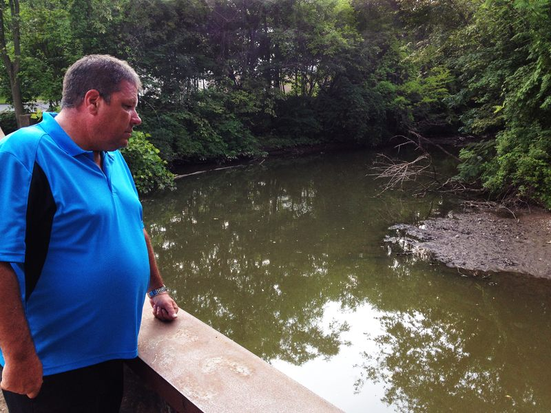 Hillsdale Fire Department Captain Tom Kelley looks out on the Pascack Brook, a source of regular flooding in his community