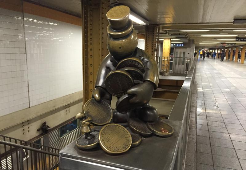 Otterness sculpture, MTA subway money (Kate Hinds)