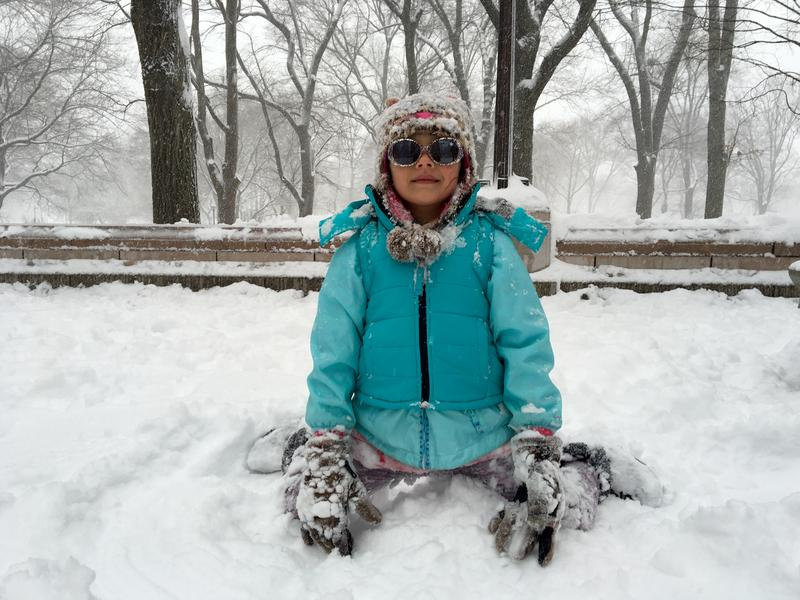 Kinsey Hough, on vacation from Florida, plays in the snow in Central Park. (Sarah Gonzalez/WNYC)!