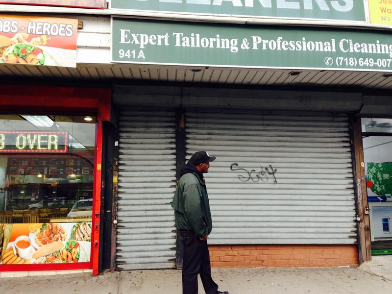 Outreach worker Rob walks along a strip of shops in East New York. He considers the area a hot spot for violence.