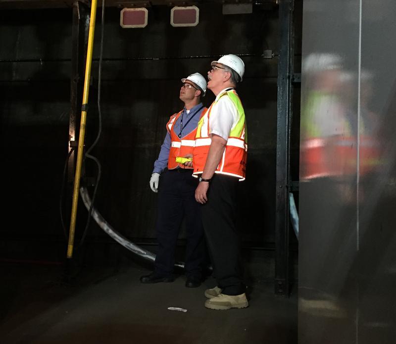 Amtrak engineer Ray Verrelle (L) showing Amtrak President Joe Boardman a troublesome cable
