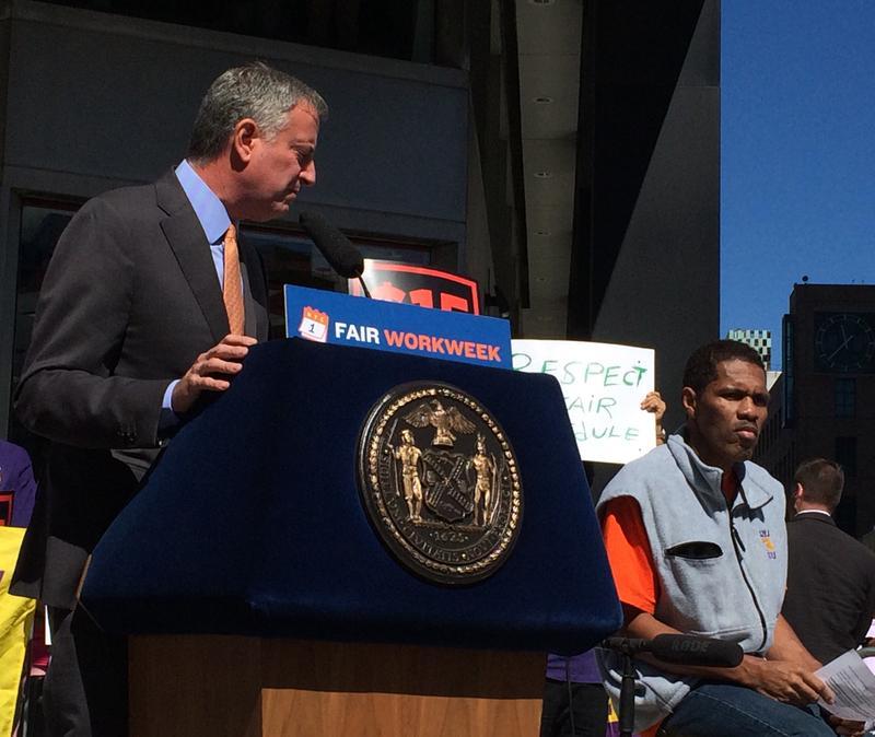 Mayor de Blasio with fast food worker Alvin Major