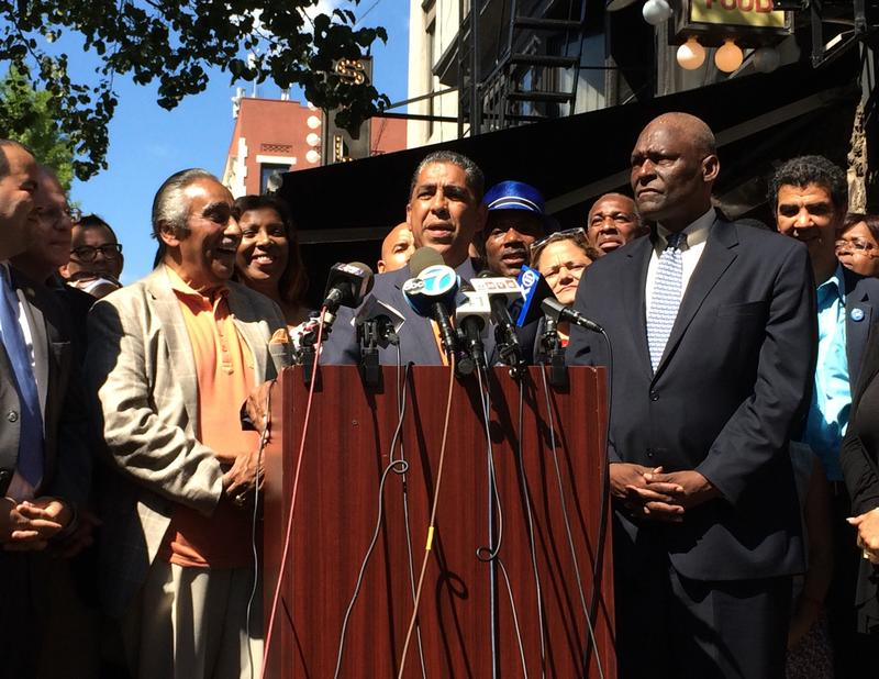 Congressman Charles Rangel and Assemblyman Keith Wright flank Senator Adriano Espaillat, the winner of the 13th congressional district Democratic primary