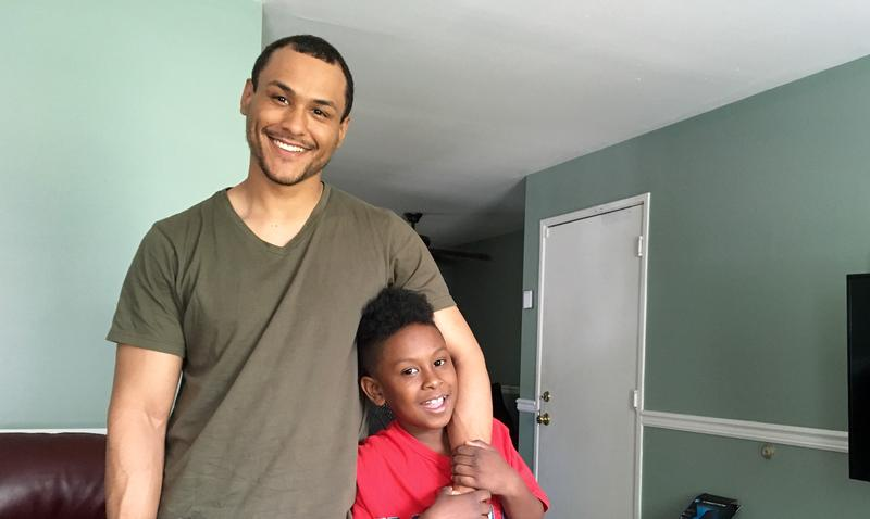 A former inmate, who arrived at an adult jail when he was 17 years old, with his son who was born while he was incarcerated.