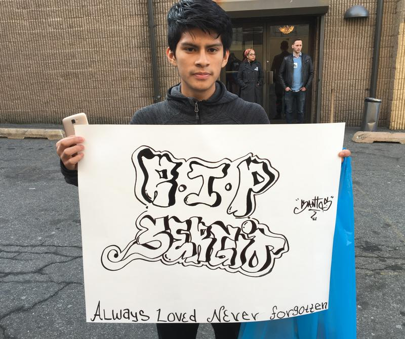 Outside the funeral of Sergio Reyes, his classmate Uriel Santos, 18, holds up a tribute he made to his friend.
