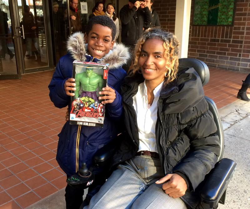 Simone Mercer and her son Elijah at Canaan Baptist Church of Christ in Harlem on Christmas Day.