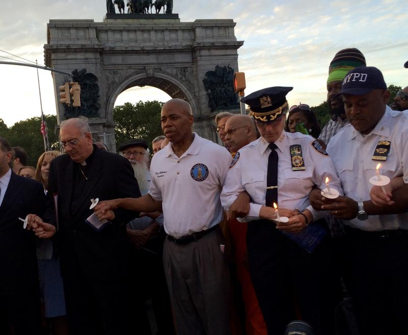 Brooklyn Borough President Eric Adams (second from left) at candlelight vigil with clergy and police