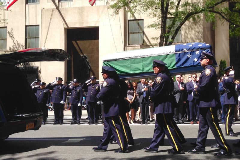 Officers carry the body of John Timoney, a former NYPD Chief of Department, down Fifth Avenue. August 23, 2016.