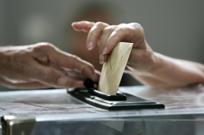 Close-up on a woman casting her ballot.