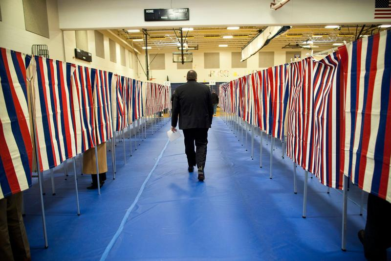 A man votes in the New Hampshire primary at Bedford High School.