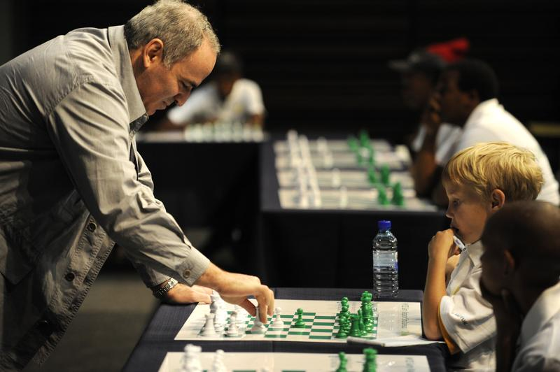 Former World Chess Champion Garry Kasparov plays a game of chess against eight-year old Ronan Ferreira on March 25, 2012in Pretoria, South Africa.