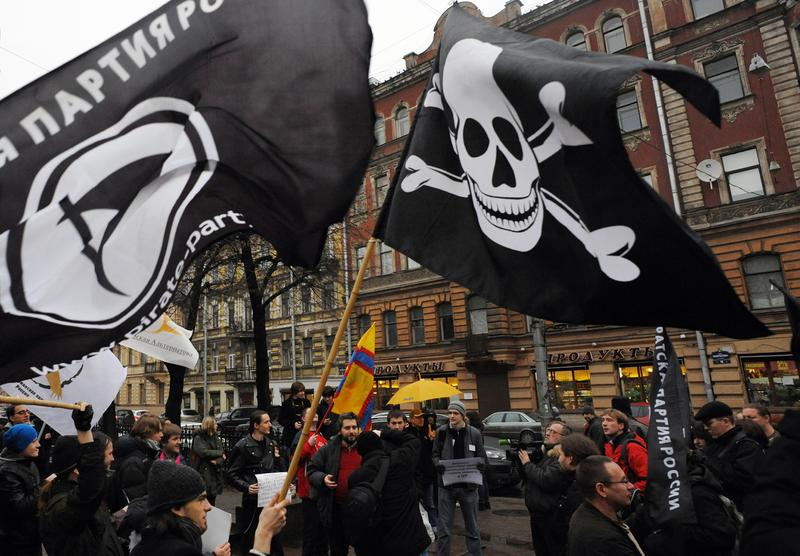 Members and supporters of anti-copyright Pirate Party take part in a rally against what they call the censorship in the Internet in Saint-Petersburg, on November 17, 2012.