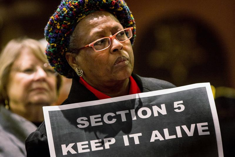 A supporter of the Voting Rights Act rallies in the South Carolina State House on February 26, 2013 in Columbia, South Carolina.