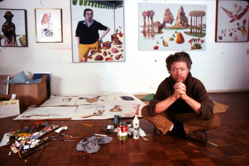 Portrait of American artist Benny Andrews (1930 - 2006) as he sits on the floor of his studio, New York, 1970s.