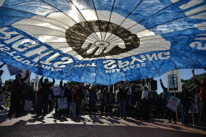 Hundreds, some carrying a message parachute, gather for a rally and march to stop NSA surveillance and government monitoring near the U.S. Capitol on Saturday, October 26, 2013, in Washington, DC.