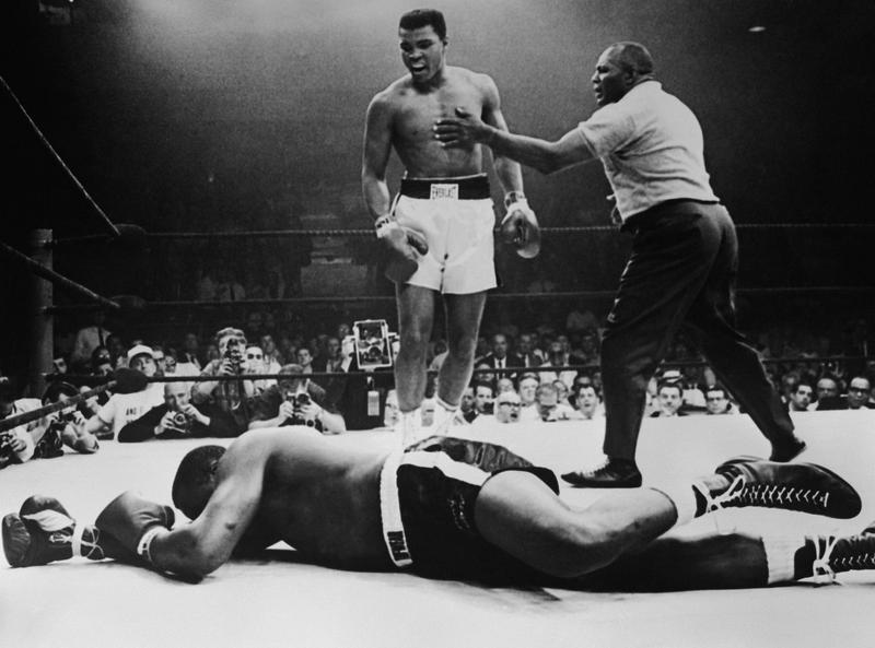 Sonny Liston lies out for the count after being KO'd in the first round of his return title fight by world heavyweight champion Muhammad Ali, Lewiston, Maine, May 25, 1965.