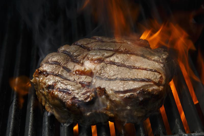A rib eye steak is grilled at a barbecue event put on by the U.S. Embassy in Berlin Germany.