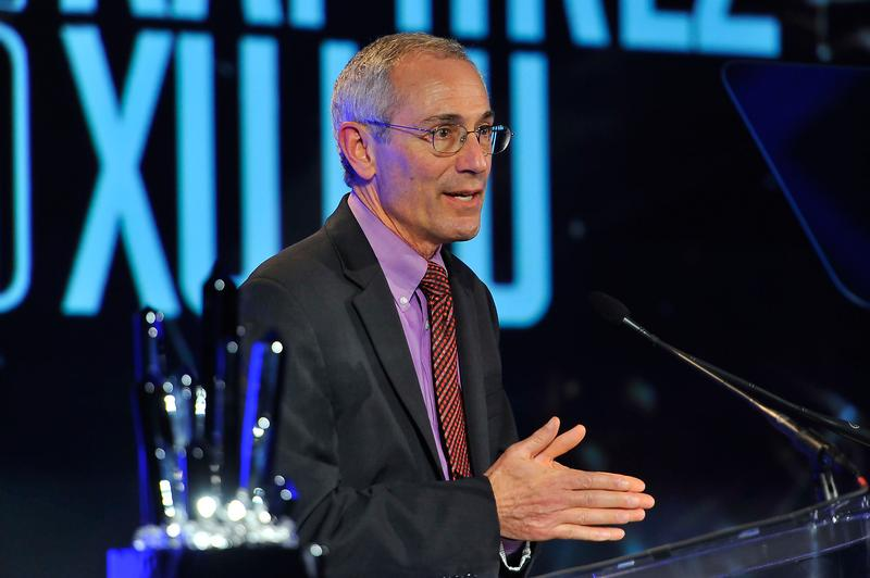 Dr. Thomas Insel presenting an award at Smithsonian Magazine's American Ingenuity Awards