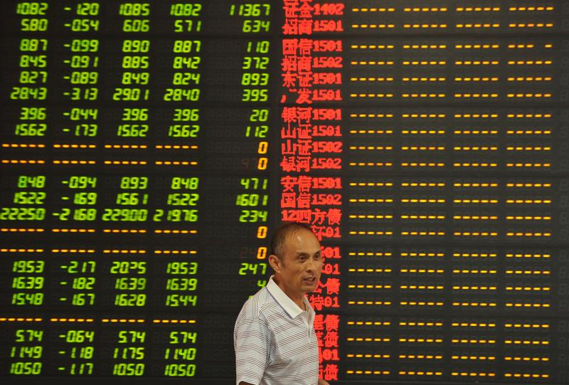 An investor observes stock market at a stock exchange hall on July 8, 2015 in Fuyang, Anhui Province of China. Chinese shares dropped sharply on Wednesday.