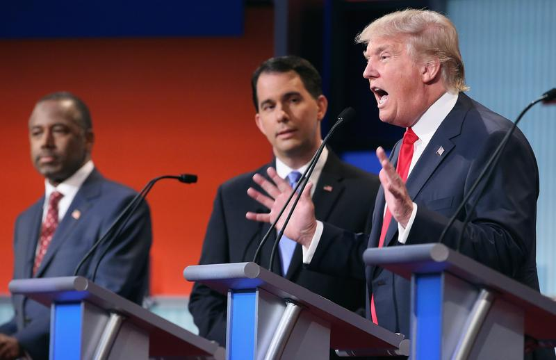CLEVELAND, OH - AUGUST 06: Republican presidential candidates (L-R) Ben Carson, Wisconsin Gov. Scott Walker and Donald Trump participate in the first prime-time presidential debate hosted by FOX News.
