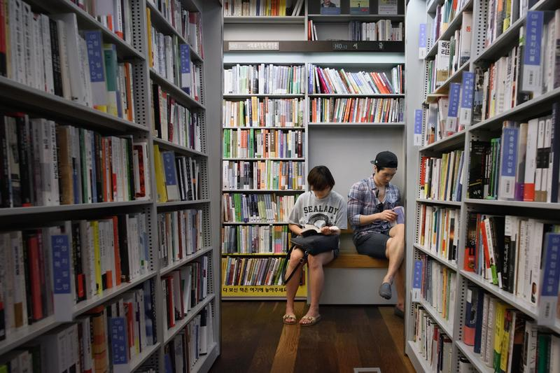 Readers browse the shelves of a Seoul bookstore.