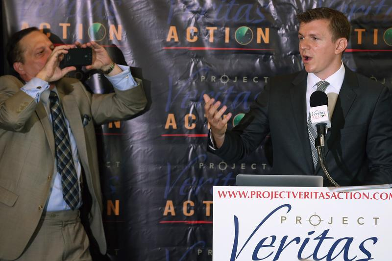 Conservative undercover journalist James O'Keefe (R) is photographed during a news conference at the National Press Club September 1, 2015 in Washington, DC.