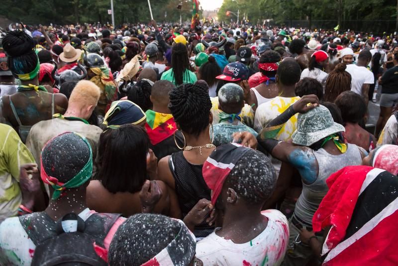 Thousands of revelers on the streets of Crown Heights for pre-dawn 'J'ouvert' street procession, a prequel to the day's West Indian Parade.
