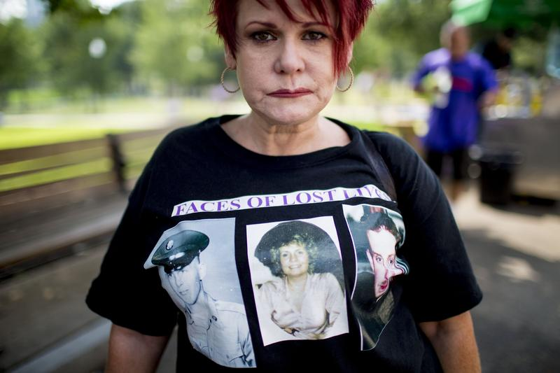 Kimberly Krawczyk wears a t-shirt of the people she has lost to drugs, including her mother, father and brother, during a rally in Boston Common on National Overdose Awareness Day.