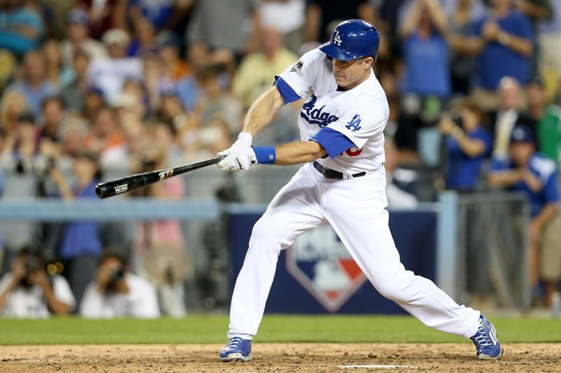 Chase Utley #26 of the Los Angeles Dodgers hits a single in the seventh inning against the New York Mets in game two of the National League Division Series at Dodger Stadium on October 10, 2015 in Lo
