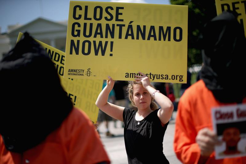 Demonstrators hold a rally to urge President Barack Obama to fulfill his pledge to close the military prison at Guantanamo Bay, Cuba, and end indefinite detention outside the White House May 23, 2014.