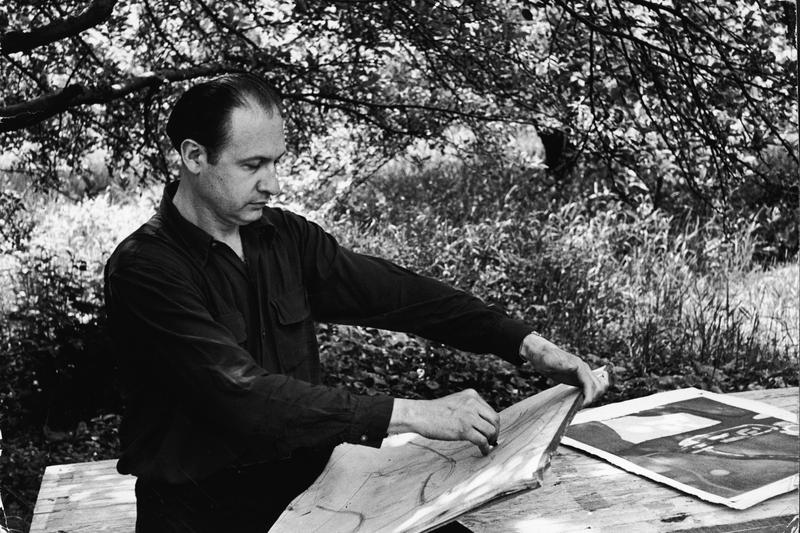 American painter Will Barnet makes a sketch under the shade of a tree, 1942.