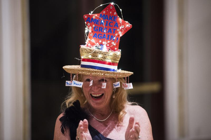 Rosemary Harder shows off her hat before republican presidential candidate Donald Trump speaks at a campaign press conference at the Mar-a-Lago club in Palm Beach, Florida on Tuesday March 15, 2016.