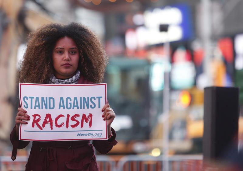 Members of MoveOn.org Political Action stand outside the studios of 'Good Morning America' to broadcast messages of love, dignity, and equality and stand up against the hate and racism. March 16, 2016