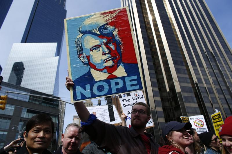 People rally as they take part in a protest against Republican presidential front-runner Donald Trump in New York on March 19, 2016.