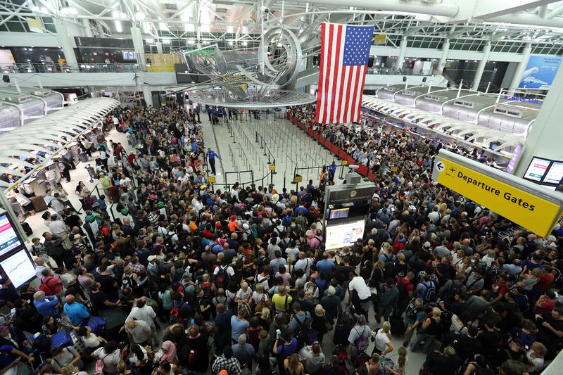 NEW YORK, Aug. 15, 2016 -- People wait for the reopening of the security check at the JFK International Airport in New York, the United States, on Aug. 15, 2016.
