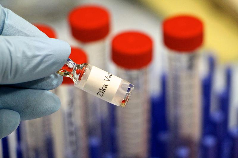 Biologist Holding Zika Vaccine At Laboratory