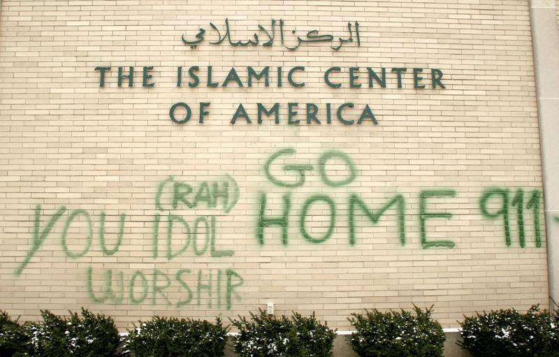 anti-Muslim graffiti on the wall of the Islamic Center of America in Dearborn, MI