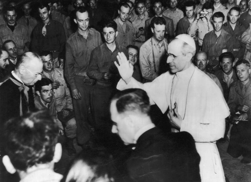 Pope Pius XII blesses a group of war correspondents in the Vatican, shortly after the liberation of Rome during World War II, 7th June 1944