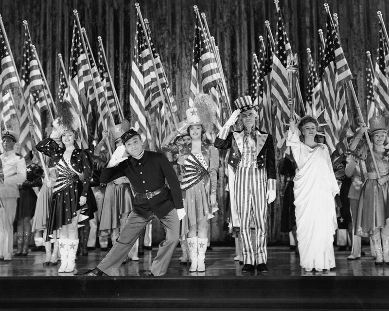 American actor James Cagney stars with Jeanne Cagney (his sister), Joan Leslie, Walter Huston, and Rosemary DeCamp in the musical biopic 'Yankee Doodle Dandy', 1942.