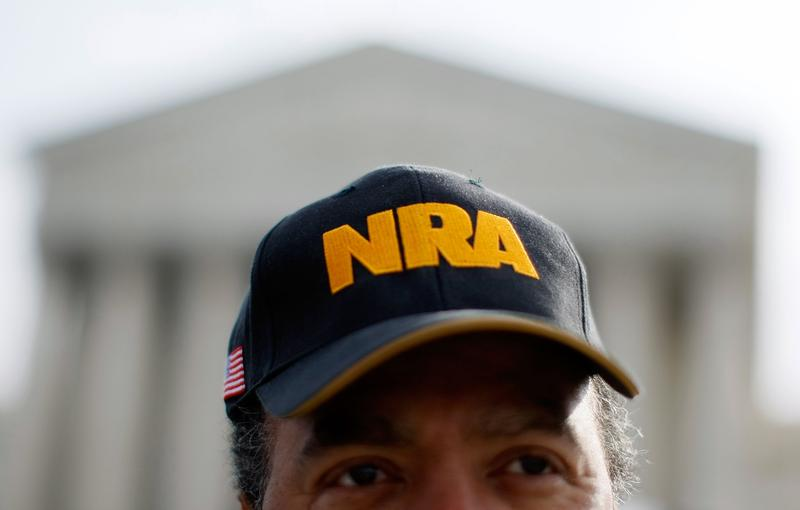 Steve Brown wears an NRA hat in front of the U.S. Supreme Court Building.