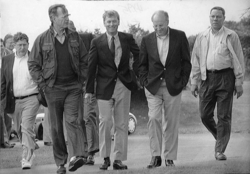 President George H.W. Bush walks with members of his cabinet, from left, John Sununu, Vice President Dan Quayle, Dick Cheney, and Colin Powell, at his home in Kennebunkport, Maine. 1990