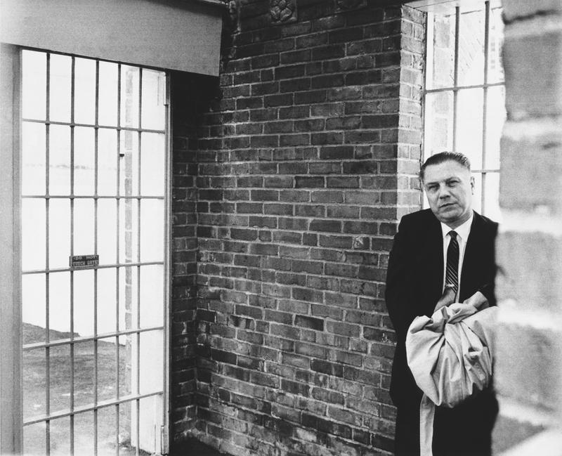 Handcuffed Teamster leader Jimmy Hoffa as he waits for the next door to open at Lewisburg Federal Prison where he will serve his eight year sentence, Lewisburg, Pennsylvania, December 9, 1967.
